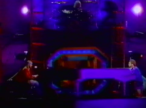Axl and Elton both playing piano.
